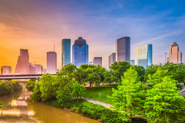 a view of the houston skyline on a sunny morning