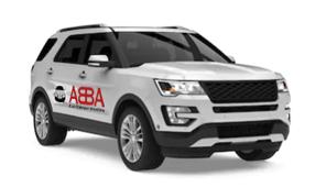 a white SUV with an Abba bus company houston logo